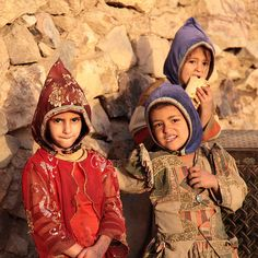 "Girls wearing a bonnet called a Qarqush, Shaharah, Yemen.  Steeped in ritual and tradition the Qarqush, Yemen's traditional headdress.  ""I remember when all the girls in Old Sana'a would put a qarqush on their heads,"" Amat Al-Razaq Jahaf, the head of the Sana'ani Heritage House, recalls.  Today, she says, it's only a handful of girls in Yemen's dwindling Jewish community that don the traditional Yemeni headdress."
