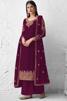 Embrace your love for fashion and inspire the rest with your uber-chic style as you wear this purple georgette trouser suit which is surely to set you apart from the rest. This U-neck and full sleeve wedding wear dress embellished in thread work and stone work. Available with santoon palazzo pant in purple color with purple georgette dupatta. Palazzo pant is plain. #trousersuit #salwarkameez #malaysia #Indianwear #Indiandresses #andaazfashion