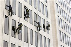 Window cleaners a glass act: Perry Window Cleaning employees — from left, Justin Hall, John Jones, Kevin Cooper, Brian McGurer and Lee Rowland — systematically wipe the glass while descending from the top of the 24-floor PNC building Downtown.