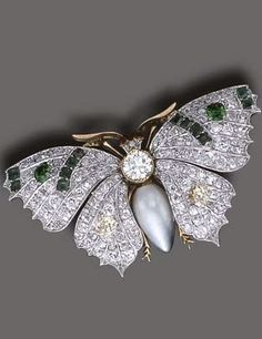 A MULTI-GEM BROOCH - Designed as a butterfly, the drop-shaped pearl and diamond collet body, with ruby collet eyes and polished gold antennae, extending pavé-set diamond wings, enhanced by old European-cut yellow diamonds, square-cut emeralds and oval-cut demantoid garnets, mounted in platinum and gold, circa 1900
