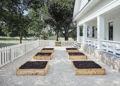 One of the first things Brooke loved about the house was the original white picket fence, but since it was old and not sturdy we rebuilt a new one and build some raised garden beds inside.