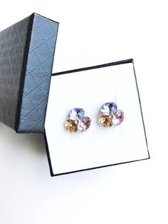Remarkable flower stud earrings made with Swarovski Crystals violet, light peach, provence lavender and 925 silver settings Provence Lavender, Flower Stud, Light Peach, Earrings Handmade, 925 Silver, Swarovski Crystals, Stud Earrings, Trending Outfits, Unique Jewelry