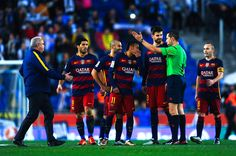 FC Barcelona players argue with the referee Jose Luis Gonzalez Gonzalez at the end of the La Liga match between RCD Espanyol and FC Barcelona at Cornella-El Prat Stadium on January 2, 2016 in Barcelona, Catalonia.