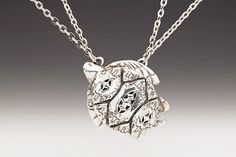 """This cute sea creature was inspired by the intricate details of vintage demitasse spoon patterns, seen throughout sea turtle's shell and fins!  ? Length: 16-18"""" adjustable chain, lobster closure  ? Pendant: 1 1/2"""" x 1 1/4""""  ? Silver Plate  ? Made in the USA      Necklace by Silver Spoon Jewelry is hand made from antique silverware patterns from the 1800's. Modern yet romantic, this vintage-style bracelet is perfect for that special lady in your life! Enjoy the elegance of the past everyday."""