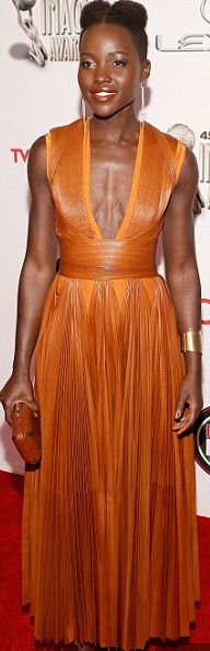 "Lupita Nyong'o.  looks like she could be on ""Firefly"" with this dress.  love it!"