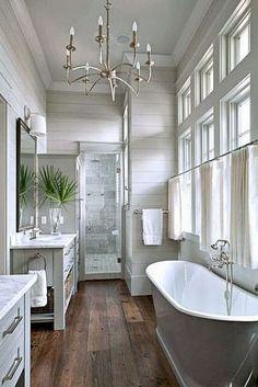 Beautiful bath : rustic wood floors, shiplap, chandelier, grey vanity