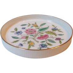 Minton China Haddon Hall Gold Trim Wine Bottle Coaster Saucer England Have similar coaster but with gold snowflakes only-no flowers.  Only 1.