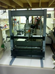 Shop Press by modmotor46 -- Homemade shop press constructed from steel channel, springs, and angle iron. Powered by a 20-ton bottle jack. http://www.homemadetools.net/homemade-shop-press-17