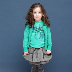 Tumble and Dry shirt with a colorfull animal print of a deer #olliewood #kidsfashion