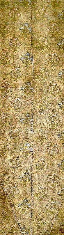 "Flowers in ogees sewn together fragments, 7"" wide x 23"" long Undated, probably 17th c."