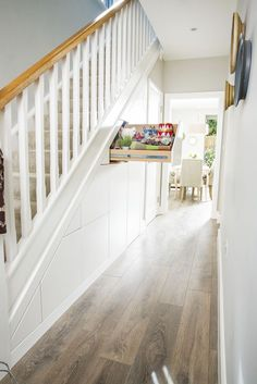 Space-creating ideas: Hallways Make the most of your under-stairs area with this stylish and practical idea. Create a secret hideaway with a pull out drawer, [. Staircase Storage, Hallway Storage, Stair Storage, Staircase Design, Storage Spaces, Paint Storage, Shoe Storage Under Stairs, Staircase Landing, Hidden Storage