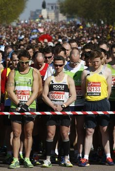 A powerful image of the runners during the moment of silence - Photos From The London Marathon Showing Support ForBoston