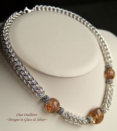 Elegant Sterling Silver Full Persian Chainmaille surrounds these stunning amber transparent lentil shape lamp work beads with lovely streamers of Double Helix Terra glass winding through them, completed with a swivel lobster claw c Wire Wrapped Earrings, Wire Earrings, Wire Jewelry, Beaded Jewelry, Handmade Jewelry, Wire Bracelets, Necklaces, Jewellery, Jewelry Patterns