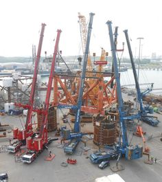 several Heavy Mobile Cranes lifting together,a pre-constructed Megastructure