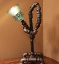 twisted industrial style pipe lamp with glass insulator