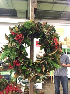 I adore this Magnolia leaf wreath....welcome to a Southern Christmas... Want to Make Your Own Fresh Wreath?