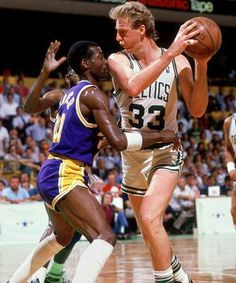 Michael Cooper (Los Angeles Lakers) and Larry Bird