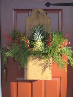 Colonial Christmas Door Box With Fresh Greenery,Berries & The Traditional Colonial Pineapple. Primitive Christmas, Country Christmas, Winter Christmas, Christmas Holidays, Christmas Wreaths, Christmas Crafts, Christmas Decorations, Christmas Arrangements, Primitive Crafts