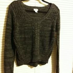 Black and gray sweater nwot Scoop neckline, long sleeves, with open crochet like yarn down sides and around sleeves. Slightly longer in back. Size lg, but fits more like,a med, cotton and linen blend. New Mossimo Supply Co Sweaters Crew & Scoop Necks