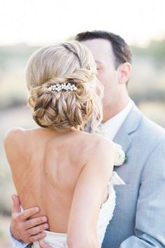 twisted low messy wedding chignon hairstyle and backless wedding gown