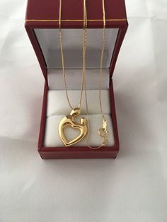 A personal favorite from my Etsy shop https://www.etsy.com/listing/544980296/14k-gold-mother-and-child-heart-pendant