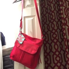 Beautiful tomatoe Red Cross hand bag New with tags. Several compartments... Very comfortable to carry Bags
