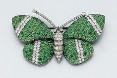 Tsavorite Garnet and Diamond Butterfly Brooch -  Blackened 18 kt. white gold, 182 green garnets ap. 6.75 cts., 133 diamonds ap. 2.15 cts., ap. 10 dwt.