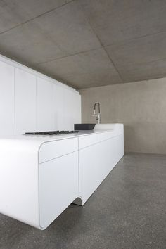 White Kitchen, Concrete Walls, Ceiling And Floor, And DuPont™ Corian® Bench  Top