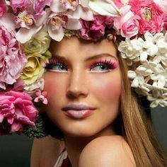 Gorgeous beauty shot with the model's hair adorned with so many fresh hydrangeas, peonies, lillies of shades of pink & blush. The make-up compliments such a beautiful expression of Spring.