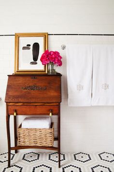 Looking to redecorate or update your bathroom? Add an antique furniture piece for a vintage appeal—bonus points for adding a vase of fresh flowers. 11 interior design tips to making any bathroom look luxe: