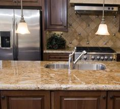 A cream colored countertop goes well with dark and light cabinets