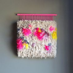 This colorful tapestry was delicately hand woven with a bunch of wool, cotton threads and some scraps like ribbons and fabric.  I realized this tapestry