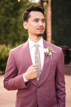 Looking for a unique groom's suit? We love when guys aren't afraid to show their sense of style! This styled shoot at the Providence Cotton Mill was full of inspiration, and this mauve suit was no exception! Our stylist paired it with a vintage looking floral tie that subtly added interest. Continue through this pin to see how this look complemented the rest of the day! #delongphotography #groomsuit #groomssuit #groomwear #providencecottonmill Casual Groomsmen Attire, Groomsmen Grey, Navy Groom, Pink Wedding Colors, Cotton Mill, Modern Wedding Inspiration, Groom Wear, Floral Tie, Mauve