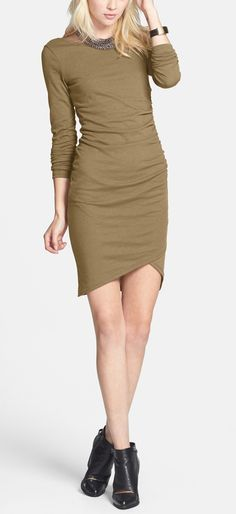 The flattering ruching of this soft olive green knit dress highlights curves in all the right ways.