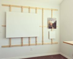 New studio is up and running. I'm particularly proud of this wall easel I designed and built. It holds numerous paintings at once and they can be moved by switching the dowels in and out. The walls...