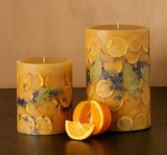 velas artesanales con frutos y flores secas