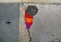 Artist Juliana Santacruz Herrera takes yarn bombing to the streets -- literally -- with the creative and colorful Projet Nid de Poule (Project Pothole, Paris Yarn Bombing, Guerilla Knitting, Tricot D'art, Art Intervention, Urbane Kunst, Knit Art, Textiles, Land Art, Fabric Decor
