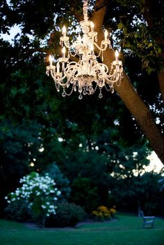 A beautiful chandelier hangs in a tree as decor for a wedding at the Woolverton Inn. The elegant bed and breakfast is the perfect wedding venue near Bucks County and New Hope, PA.