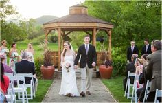 Happy bride and groom walk down the aisle at the end of their outdoor spring wedding ceremony in front of the gazebo at Denver Botanic Gardens Chatfield Farms in Colorado. - April O'Hare Photography http://www.apriloharephotography.com