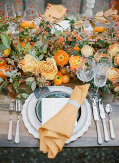 Orange ranunculus and rose topped wedding table: http://www.stylemepretty.com/2016/10/31/fall-wedding-orange-color-palette/ Photography: Sylvie Gil - http://www.sylviegilphotography.com/