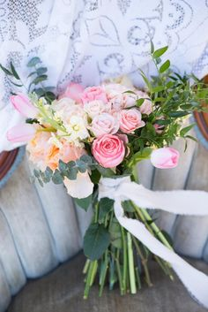 Featured on The Lovely Find  Candy Pastels Bridal and Wedding Inspirations  Planning + Design + Styling + Florals by Wrennwood Design // Photography by Laura Barnes Photo  Farm Garden Field Wedding Vintage // Lace // Garden Roses // Sunrise // Photo Shoot // Bicycle // Pink // Peach // Yellow // Greenery // Floral Arrangement // Flowers // Ranunculus  pastel rose bridal bouquet