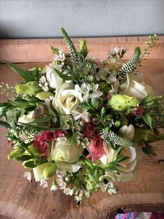 Fresh summer brides bouquet of roses, Veronica, chins and lizzy for a wedding at Melmerby Hall