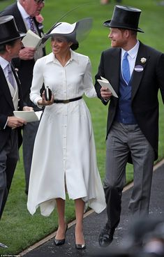Meghan opted for an elegant white shirt dress by wedding designer Givenchy, which she paired with black heels