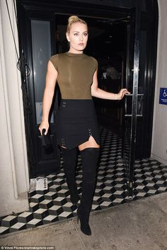 All eyes on her! Lindsey Vonn looked sensational in a black mini skirt, thigh-high boots, ...