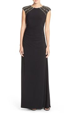Free shipping and returns on Vince Camuto Embellished Jersey A-Line Dress at Nordstrom.com. Glittery crystals and metallic studs draw the eye up to a pretty face while the ruched bodice prefects the figure of this comfortably stretchy evening gown.