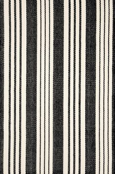 Dash & Albert   Birmingham Black Woven Cotton Rug   Our woven cotton area rugs are so adaptable they make themselves at home in any room. Constructed using a hand loomed flat weave in durable 100% cotton, these rugs are lightweight, reversible and affordable.
