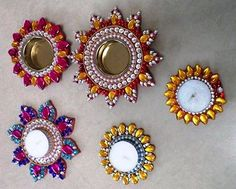 Simple but festive look for diya gives your home decoration a different look