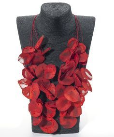Paper Petals Necklace - Jewelry designer Ana Hagopian was born and educated in Argentina. Since 1980 she has lived and worked in Barcelona. Each necklace is handmade in Hagopian's Barcelona studio and features a button-hole clasp.