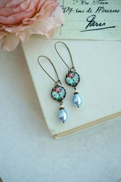 Hey, I found this really awesome Etsy listing at https://www.etsy.com/listing/130870388/blue-and-pink-red-floral-pearl-earrings