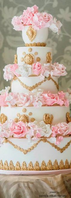 Wedding cake - pink roses, white tiered wedding cake and gold decorations...